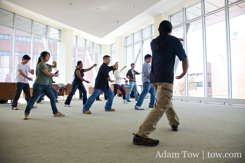 Adam demonstrates Tai-Chi to the assembled UMass students.