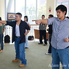 UMass students punching during wushu basics demonstration.