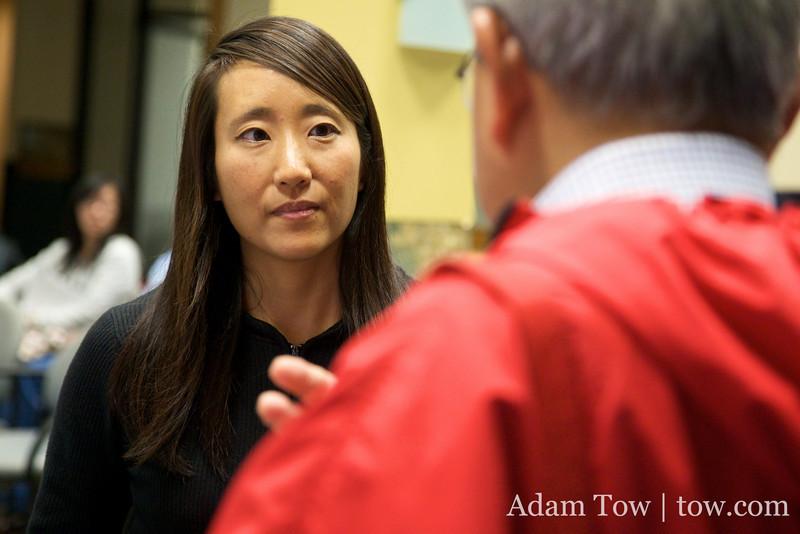 Rae listens to Professor John Eng-Wong.