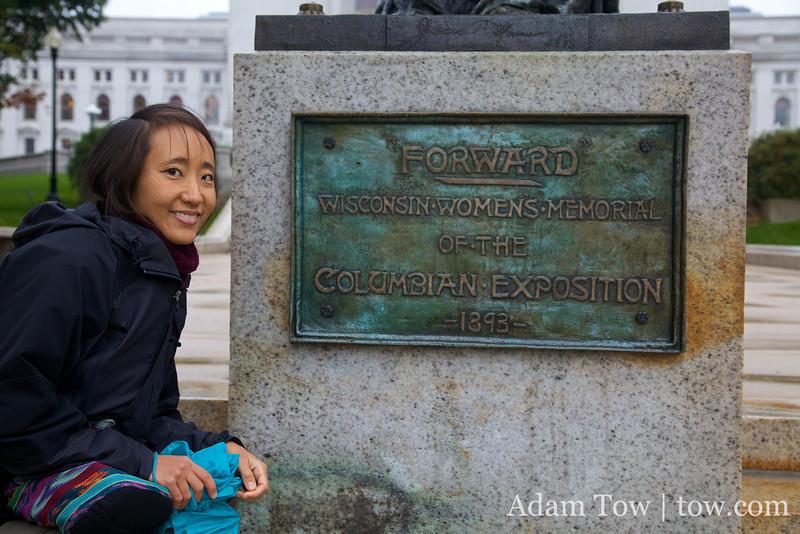 Rae next to the Wisconsin Women's Memorial statue.