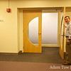 Professor Giesrch holds open the door to the screening room.