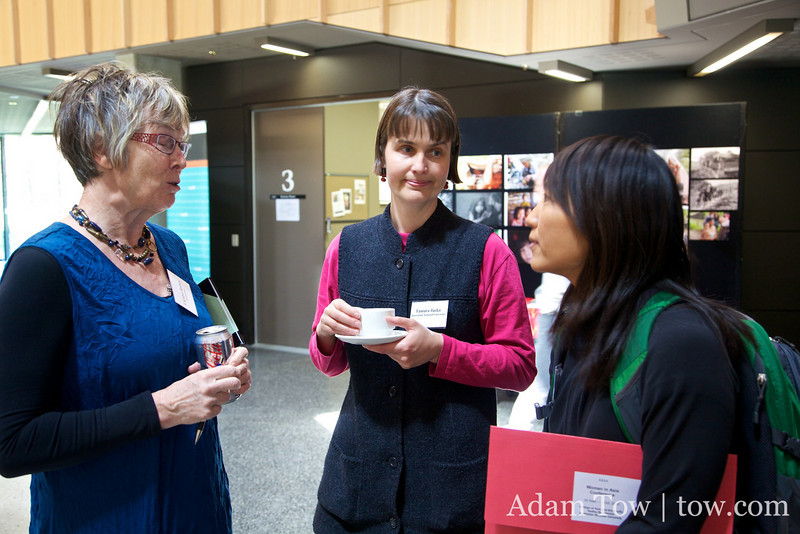 Rae speaks with conference organizer Tamara Jacka and Carolyn Brewer from ANU.