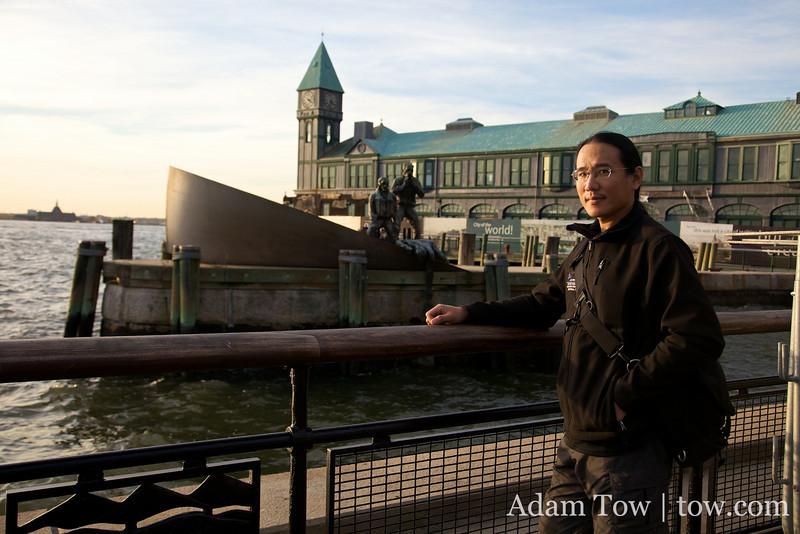 Adam standing in front of a statue of Merchant Marines.