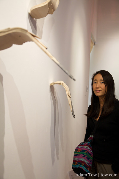 Rae stands in front of her friend, Effie Phillips art piece in the Macy Art Gallery at Columbia University.