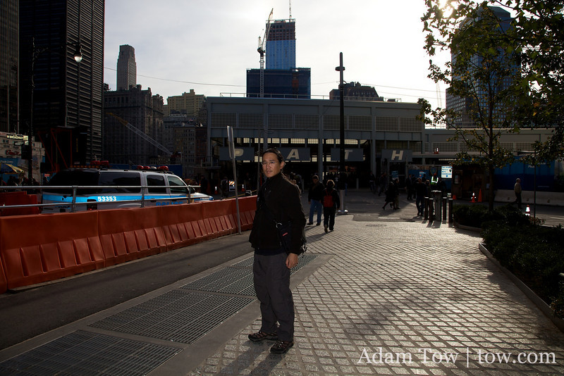 Adam stands near the site of the former World Trade Center.
