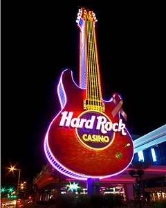 Guitar out front of the Hard Rock Casino on the beach in Biloxi, Ms. Only one guitar string lights up at a time on the guitar but through the magic of photography I captured all six strings.