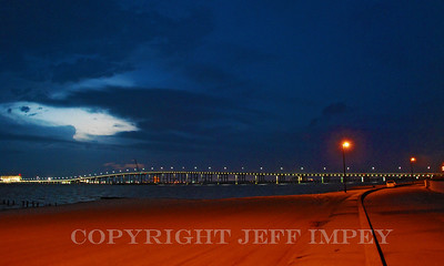 Biloxi Bay Bridge at night time from the Ocean Springs, Mississippi beach