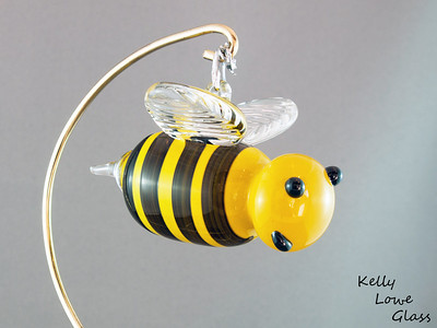 """Hanging Glass Bee Picture 2:  A seasonal favorite, or a feared adversary, the bee can be either depending on the individual. But where would we be without them? Less flowers, no honey and 54% less buzzing in the world... would you REALLY want that?  Some of these bees even come with crowns, showing off their royal status as queen bees.  Stinger to Nose: Approx 9cm (3.54"""") Across the Wings: Approx 6cm (2.36"""") Weight: Approx 150g (0.33 lbs)"""