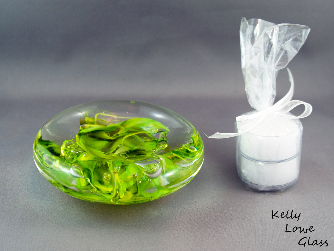 """Green Candle Holder  Dimensions:  Width: Approx 9 to 11.5cm (3.54"""" - 4.53"""") Height: Approx 3 to 3.5cm (1.18"""" - 1.38"""") Weight: Approx 422 to 576g. (0.93 - 1.27 lbs)  Please note: as each piece begins its life as molten glass and is blown/sculpted by hand into the final product, individual pieces might have slight variations in size and/or appearance. Please rest assured however that the standard of quality is quite high, and no substandard pieces will be sold."""