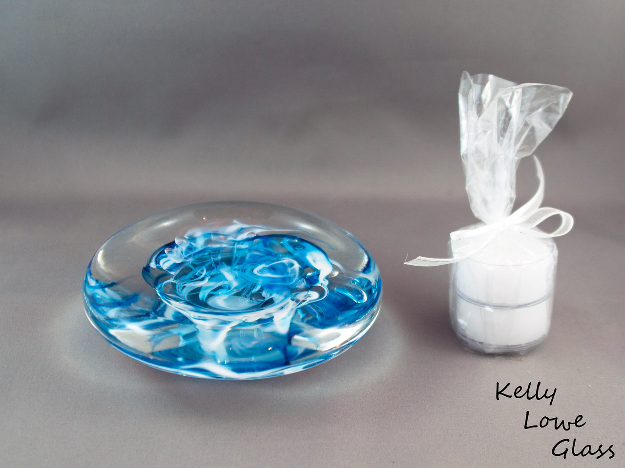 """Blue and White Candle Holder  Dimensions:  Width: Approx 9 to 11.5cm (3.54"""" - 4.53"""") Height: Approx 3 to 3.5cm (1.18"""" - 1.38"""") Weight: Approx 422 to 576g. (0.93 - 1.27 lbs)  Please note: as each piece begins its life as molten glass and is blown/sculpted by hand into the final product, individual pieces might have slight variations in size and/or appearance. Please rest assured however that the standard of quality is quite high, and no substandard pieces will be sold."""