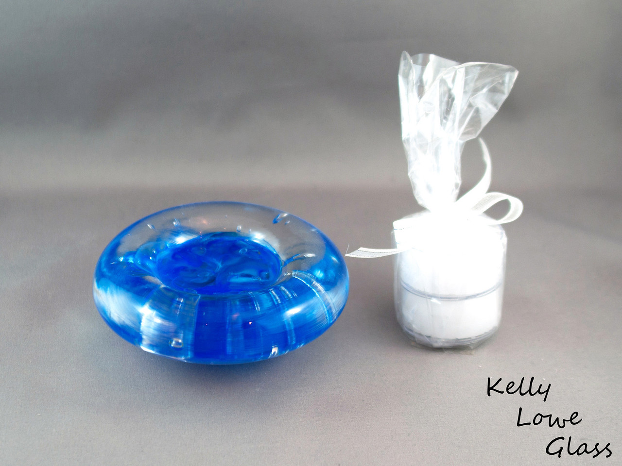 "Dark Blue Candle Holder  Dimensions:  Width: Approx 9 to 11.5cm (3.54"" - 4.53"") Height: Approx 3 to 3.5cm (1.18"" - 1.38"") Weight: Approx 422 to 576g. (0.93 - 1.27 lbs)  Please note: as each piece begins its life as molten glass and is blown/sculpted by hand into the final product, individual pieces might have slight variations in size and/or appearance. Please rest assured however that the standard of quality is quite high, and no substandard pieces will be sold."