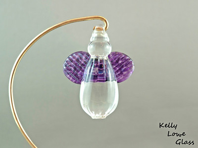 "Hanging Glass Angel - Purple  Height: Approx 8cm (3.15"") Across the Wings: Approx 5.5cm (2.17"") Depth: Approx 3cm (1.19"") Weight: Approx 85g (0.19 lbs)  *Brass hanger in pictures is not included  Please note: as each piece begins its life as molten glass and is blown/sculpted by hand into the final product, individual pieces might have slight variations in size and/or appearance. Please rest assured however that the standard of quality is quite high, and no substandard pieces will be sold."