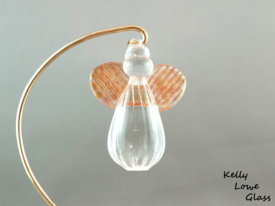 "Hanging Glass Angel - Apricot  Height: Approx 8cm (3.15"") Across the Wings: Approx 5.5cm (2.17"") Depth: Approx 3cm (1.19"") Weight: Approx 85g (0.19 lbs)  *Brass hanger in pictures is not included  Please note: as each piece begins its life as molten glass and is blown/sculpted by hand into the final product, individual pieces might have slight variations in size and/or appearance. Please rest assured however that the standard of quality is quite high, and no substandard pieces will be sold."