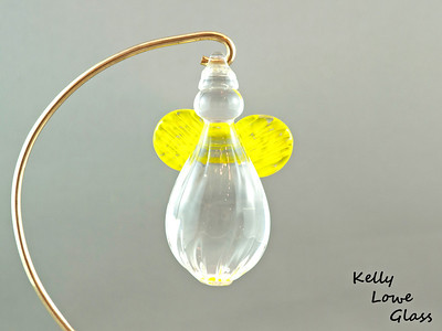 "Hanging Glass Angel - Yellow  Height: Approx 8cm (3.15"") Across the Wings: Approx 5.5cm (2.17"") Depth: Approx 3cm (1.19"") Weight: Approx 85g (0.19 lbs)  *Brass hanger in pictures is not included  Please note: as each piece begins its life as molten glass and is blown/sculpted by hand into the final product, individual pieces might have slight variations in size and/or appearance. Please rest assured however that the standard of quality is quite high, and no substandard pieces will be sold."