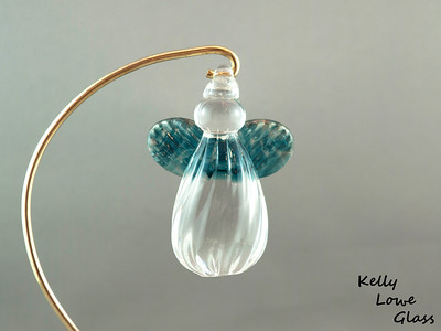 "Hanging Glass Angel - Aqua  Height: Approx 8cm (3.15"") Across the Wings: Approx 5.5cm (2.17"") Depth: Approx 3cm (1.19"") Weight: Approx 85g (0.19 lbs)  *Brass hanger in pictures is not included  Please note: as each piece begins its life as molten glass and is blown/sculpted by hand into the final product, individual pieces might have slight variations in size and/or appearance. Please rest assured however that the standard of quality is quite high, and no substandard pieces will be sold."