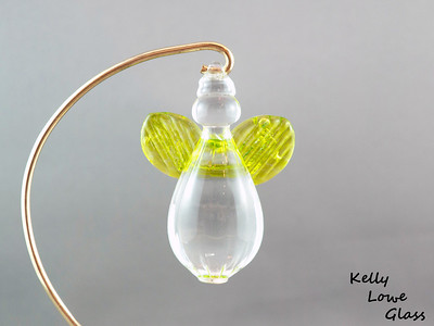 "Hanging Glass Angel - Lime Green  Height: Approx 8cm (3.15"") Across the Wings: Approx 5.5cm (2.17"") Depth: Approx 3cm (1.19"") Weight: Approx 85g (0.19 lbs)  *Brass hanger in pictures is not included  Please note: as each piece begins its life as molten glass and is blown/sculpted by hand into the final product, individual pieces might have slight variations in size and/or appearance. Please rest assured however that the standard of quality is quite high, and no substandard pieces will be sold."