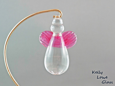"Hanging Glass Angel - Pink  Height: Approx 8cm (3.15"") Across the Wings: Approx 5.5cm (2.17"") Depth: Approx 3cm (1.19"") Weight: Approx 85g (0.19 lbs)  *Brass hanger in pictures is not included  Please note: as each piece begins its life as molten glass and is blown/sculpted by hand into the final product, individual pieces might have slight variations in size and/or appearance. Please rest assured however that the standard of quality is quite high, and no substandard pieces will be sold."