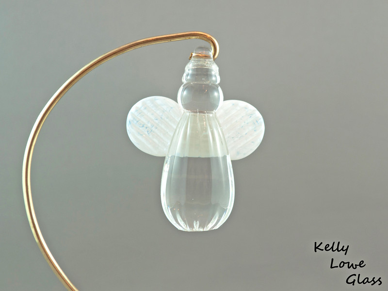 """Hanging Glass Angel - White  Height: Approx 8cm (3.15"""") Across the Wings: Approx 5.5cm (2.17"""") Depth: Approx 3cm (1.19"""") Weight: Approx 85g (0.19 lbs)  *Brass hanger in pictures is not included  Please note: as each piece begins its life as molten glass and is blown/sculpted by hand into the final product, individual pieces might have slight variations in size and/or appearance. Please rest assured however that the standard of quality is quite high, and no substandard pieces will be sold."""