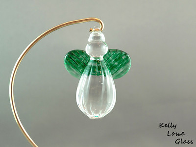 "Hanging Glass Angel - Green  Height: Approx 8cm (3.15"") Across the Wings: Approx 5.5cm (2.17"") Depth: Approx 3cm (1.19"") Weight: Approx 85g (0.19 lbs)  *Brass hanger in pictures is not included  Please note: as each piece begins its life as molten glass and is blown/sculpted by hand into the final product, individual pieces might have slight variations in size and/or appearance. Please rest assured however that the standard of quality is quite high, and no substandard pieces will be sold."