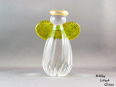 Glass Angel - Large - Lime Green  Height: Approx 12cm Across the Wings: Approx 8.5cm Depth: Approx 5cm Weight: Approx 472g.  Please note: as each piece begins its life as molten glass and is blown/sculpted by hand into the final product, individual pieces might have slight variations in size and/or appearance. Please rest assured however that the standard of quality is quite high, and no substandard pieces will be sold.
