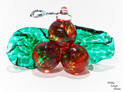 "Hanging Glass Holly:  Never wilting, fading or poisoning the cat, this hand sculpted glass holly has all sorts of advantages!  Width: Approx 11cm (3.35"") Height: Approx 6cm (2.35"") Depth: Approx 4.5cm (1.75"") Weight: Approx 125g."