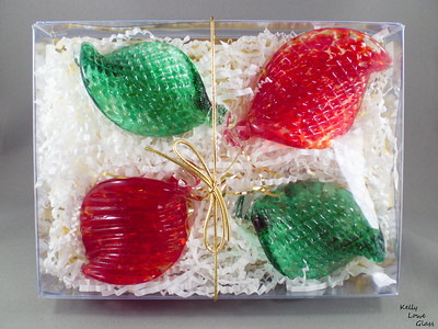 Package of Four Hand Sculpted Christmas Ornaments:  These glass ornaments are made to play with light in a way that will draw attention and add to any festive decor. Hang them from a Christmas Tree, on doors, from lights, from your nostrils, or go ahead and wear them as as kinda smallish and not very practical hat - I know you want to.  Each piece is fully handmade, and are currently available in gift boxes of four (as pictured here).