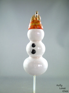 "Glass Snowman Decoration:  These hand sculpted snowmen are faceless yet fashionable, with two timeless buttons and a hat crafted just for him. Also, a fancy hanging string, and we all know how stylish those are.  Height: Approx 8.5cm (3.35"") Wide: Approx 3.5cm (1.38"") Weight: Approx 95g (0.21 lbs)"