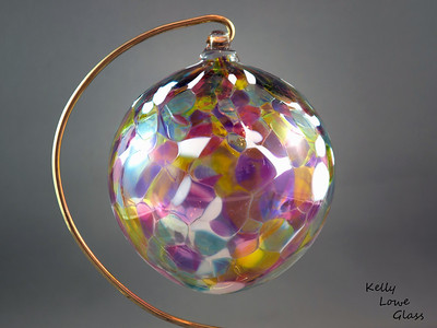 "Christmas Ornaments:  Individually hand blown using the same methods glassblowers have used since antiquity, these ornaments are a holiday classic  just like great great great great great grandma may have had.   I make these Christmas balls in a variety of colours, (see the link below for more examples) including the multicoloured one pictured here. Each ornament begins life as liquid glass in a special glassblowing furnace, from which it's pulled and blown by mouth into a hollow sphere. During this process colour is added, which melts and is allowed to flow and combine throughout ornament, making each ball truly one of a kind: the color will never mix in the same way twice. While the piece is still hot a small glass loop is added to the top to make for easy hanging from a Christmas Tree or any other place one could wish to hang it, and finally it is slowly cooled over the course of 24 hours in a special glass kiln to ensure the glass is very strong and will last a lifetime.  Diameter - Approx 9.5cm (3.75"") Weight: Approx 78g (0.17 lbs)"