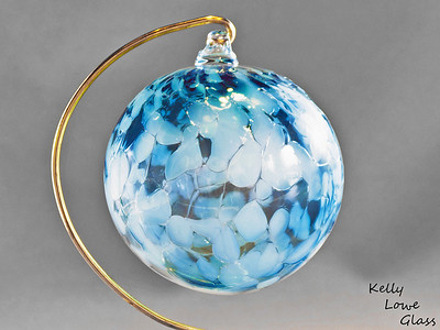"Christmas Ornaments:  Individually hand blown using the same methods glassblowers have used since antiquity, these ornaments are a holiday classic  just like great great great great great grandma may have had.   I make these Christmas balls in a variety of colours, (see the link below for more examples) including the blue one pictured here. Each ornament begins life as liquid glass in a special glassblowing furnace, from which it's pulled and blown by mouth into a hollow sphere. During this process colour is added, which melts and is allowed to flow and combine throughout ornament, making each ball truly one of a kind: the color will never mix in the same way twice. While the piece is still hot a small glass loop is added to the top to make for easy hanging from a Christmas Tree or any other place one could wish to hang it, and finally it is slowly cooled over the course of 24 hours in a special glass kiln to ensure the glass is very strong and will last a lifetime.  Diameter - Approx 9.5cm (3.75"") Weight: Approx 78g (0.17 lbs)"