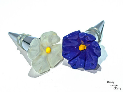 Flower Topped Winestoppers:  Glass flower tops on a wine stopper base.