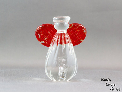 Small Angel - Red:  Height: Approx 7.5cm Across the Wings: Approx 6cm Depth: Approx 3.5cm Weight: Approx 134g.  Please note: as each piece begins its life as molten glass and is blown/sculpted by hand into the final product, individual pieces might have slight variations in size and/or appearance. Please rest assured however that the standard of quality is quite high, and no substandard pieces will be sold.