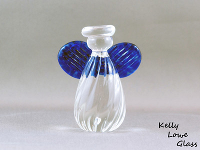 Small Angel - Blue:  Height: Approx 7.5cm Across the Wings: Approx 6cm Depth: Approx 3.5cm Weight: Approx 134g.  Please note: as each piece begins its life as molten glass and is blown/sculpted by hand into the final product, individual pieces might have slight variations in size and/or appearance. Please rest assured however that the standard of quality is quite high, and no substandard pieces will be sold.
