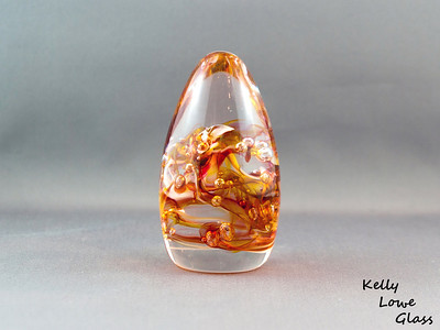 Teardrop Paperweight - Gold Topaz and White:  Widest Point: Approx 5cm Height: Approx 10cm Weight: Approx 420g.  The pictures included here are of the specific piece for sale.