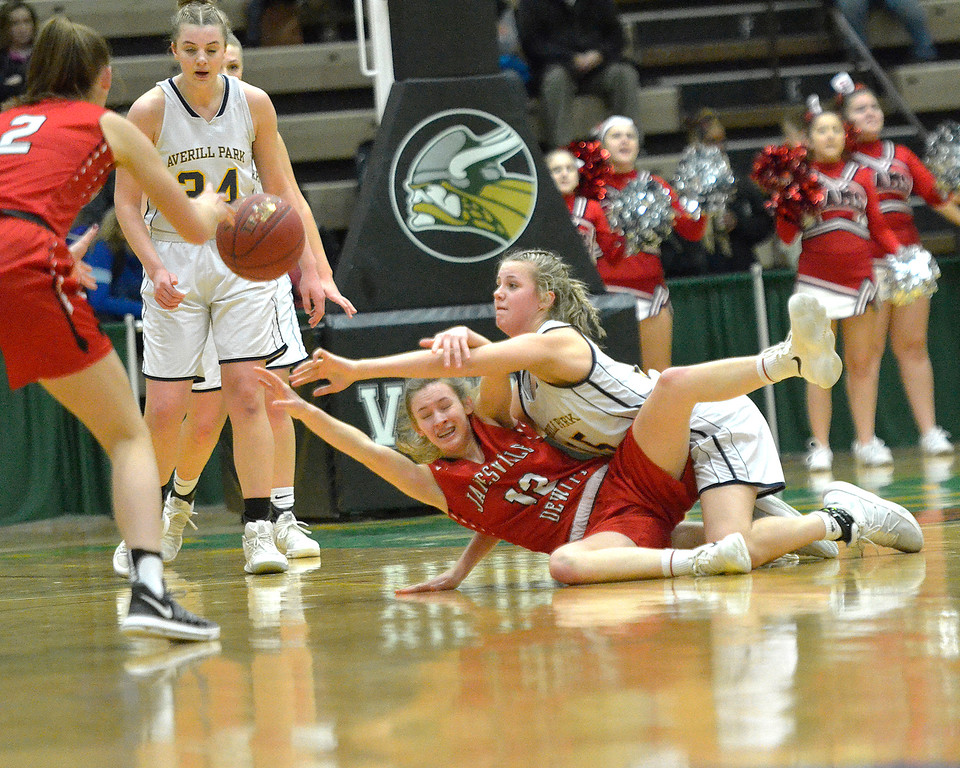 . STAN HUDY - SHUDY@DIGITALFIRSTMEDIA.COM Averill Park\'s Ameila Wood (top) dives for a loose ball, tangles up with Jamesville-DeWitt\'s Paige Keeler Saturday afternoon at Hudson Valley Community College during the NYSPHSAA Class A regional.