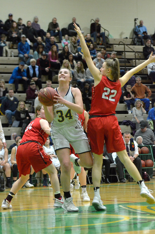. STAN HUDY - SHUDY@DIGITALFIRSTMEDIA.COM Averill Park\'s Kelsey Wood goes up for a shot, defended by Jamesville-DeWitt\'s Jamie Boeheim  Saturday afternoon at Hudson Valley Community College during the NYSPHSAA Class A regional.