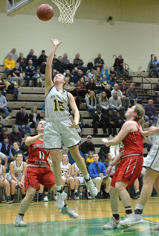 . STAN HUDY - SHUDY@DIGITALFIRSTMEDIA.COM Averill Park\'s Amelia Wood drives the lane against Jamesville-DeWitt Saturday afternoon at Hudson Valley Community College during the NYSPHSAA Class A regional.