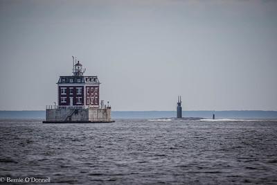 SSN-768 Hartford passing Ledge Lighthouse on the Thames River