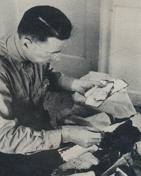 A United States Postal Inspector in Flagstaff sorting through air mail recovered from the 1956 mid-air collision at Grand Canyon, Arizona. (Life Magazine 1956).
