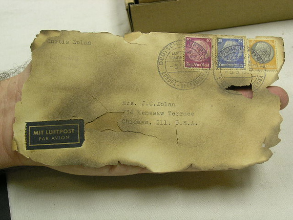 """**FAKE** HINDENBURG DISASTER CRASH COVERS<br /> <br /> This crash cover was reported to be from the German Zeppelin """"Hindenburg"""". It was determined to be a fake by experts. The over smudging on the envelope and the typed address (Passenger Dolan handwrote addresses) were the clues.  <br /> <br /> The cover never achieved a bid on it's eBay auction. The bidding began at $11,799.00. (Unknown Collection)"""