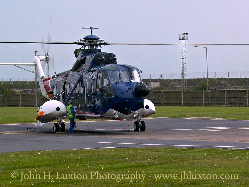 Sikorski S61N helicopter awaiting to board passengers at Penzance heliport for a flight to St. Mary's, Isles of Scilly.