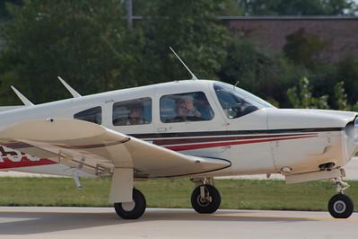 Cheri front, Alex in back, Brian flying