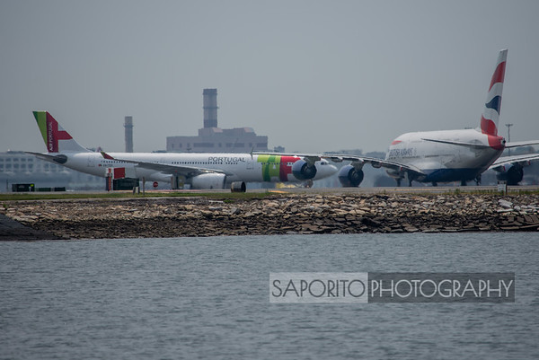 TAP A330-300 passes in front of the A-380