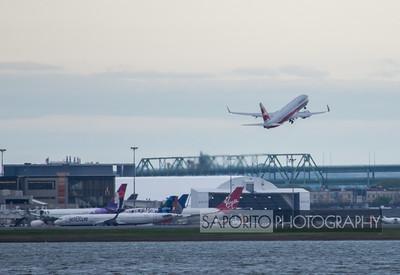 American 737-800 departs for Miami - retro TWA livery