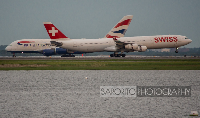 Swiss A340 landing in front of Speedbird A380
