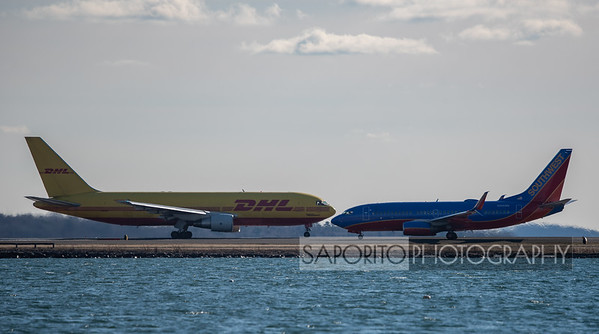 Just passing by - DHL 767 and Southwest 737-700