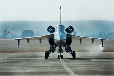 Tejas / LCA exits the runway Air breaks deployed shot at Aeroindia 2011