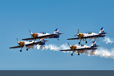 The Flying Bulls in close formation in the Zilin 50s watch the heads of the other pilots following the leader