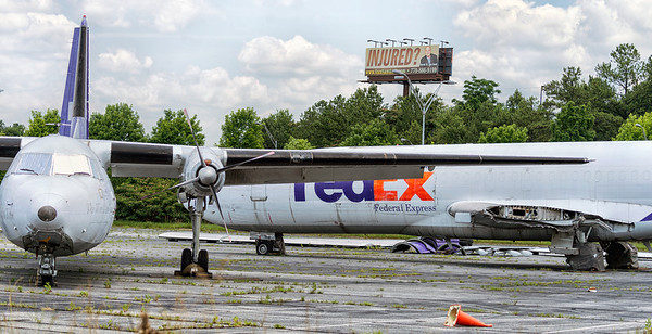 Two noble aircraft are just wasting away in the elements.   This photo was taken at the future site of the National Museum of Commercial Aircraft, just off the eastern end of the Hartsfield-Jackson airport runways. These aircraft, donated to the museum by FedEx are showing the signs of neglect, being left for years out in the elements.