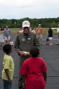 An Air Force Reserve Weather Officer talks about the Drop Drone with two young boys.