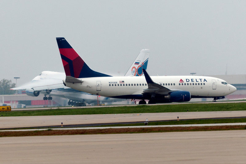 Thanks Delta! Thank you for taxing by just in time to ruin my photograph of the Antonov lifting off the runway.